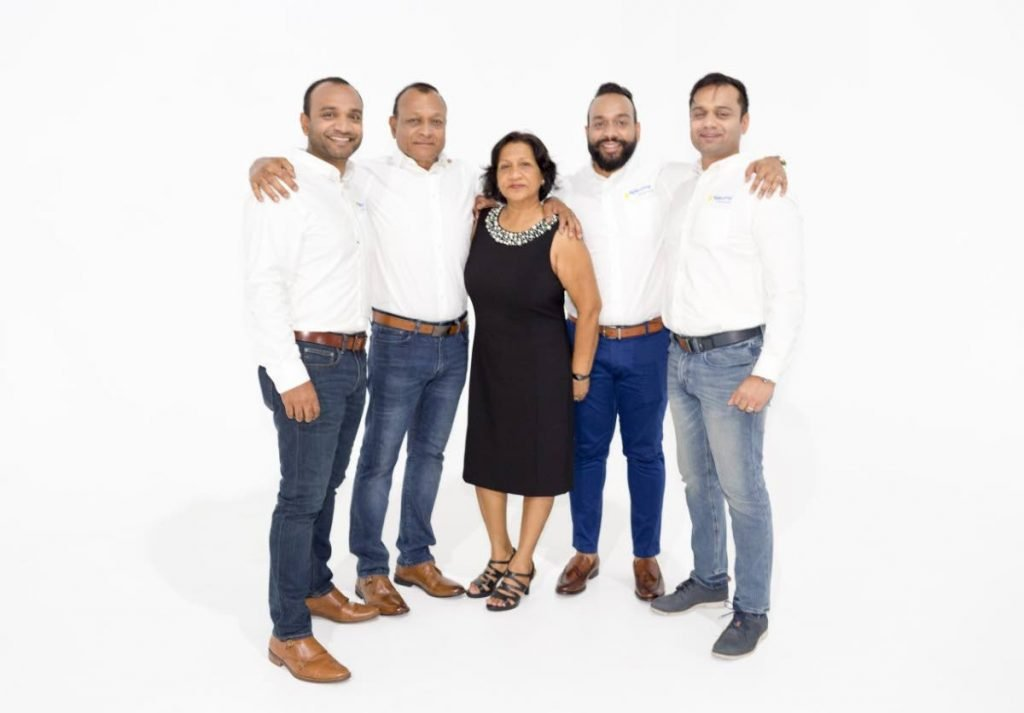 Members of the family-run Ramps Logistics Ltd from left, Robbie Rampersad, Ramnarine Rampersad, Betty Rampersad, Rudy Rampersad, and Shaun Rampersad. Ramps was named the 2020 Internationally Known TT-Owned Company of the Year at the TT Chamber of Industry and Commerce Champions of Business Awards on Friday night. - Courtesy Ramps Logistics