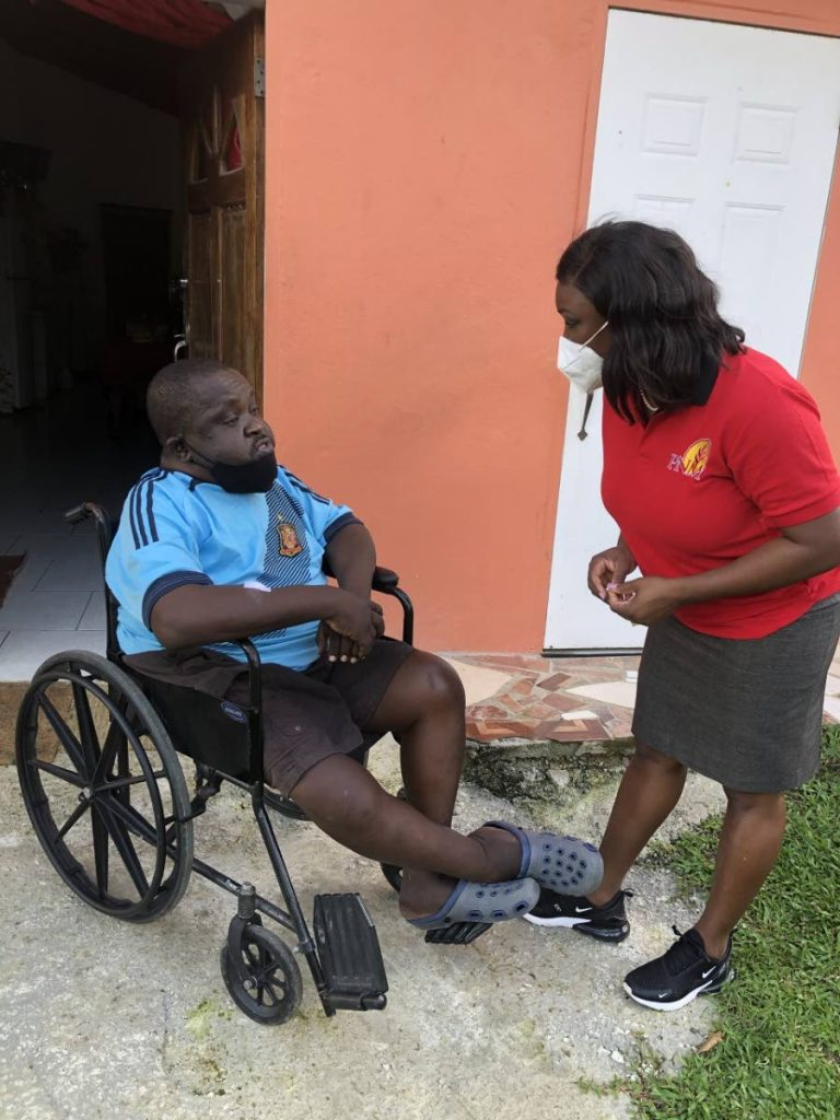 PNM Tobago Council leader Tracy Davidson-Celestine, right, chats with Eugene Bruce, one of the residents in Patience Hill, during a walkabout on Tuesday. Davidson-Celestine is the PNM candidate of Lambeau/Signal Hill in the upcoming THA election. -