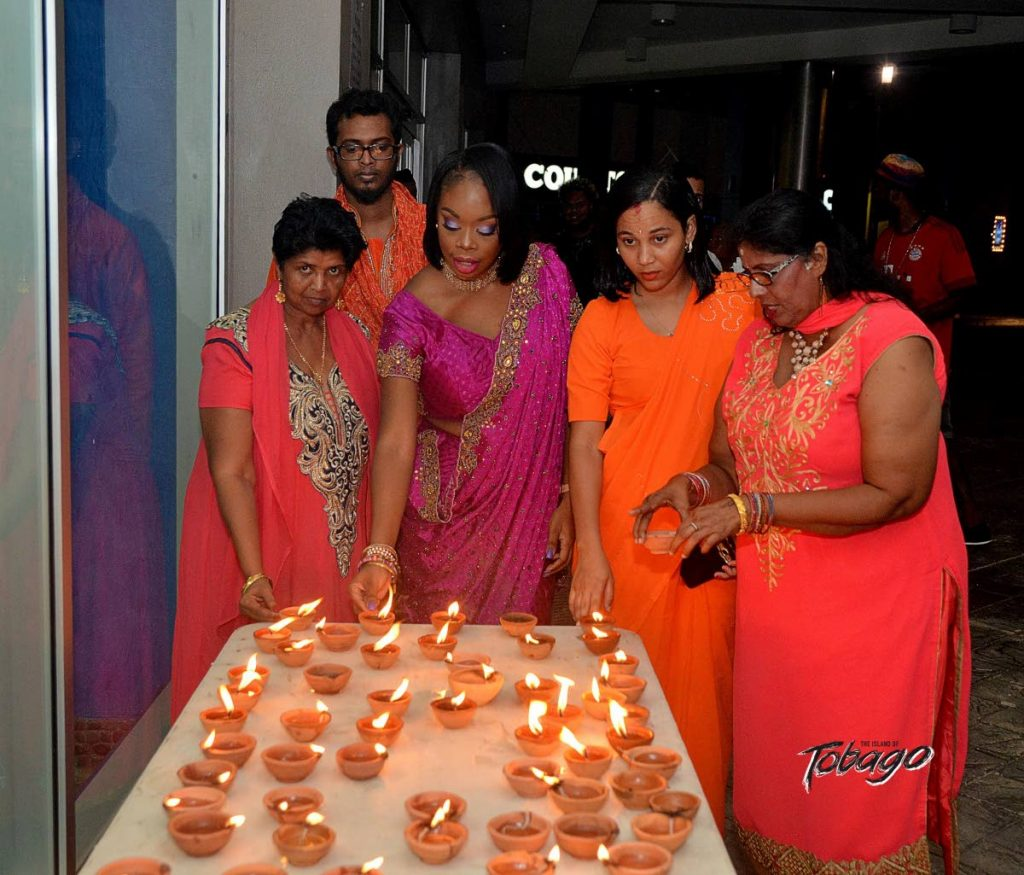 Former tourism, culture and transportation secretary Nadine Stewart-Phillips, centre, at the 2018 Tobago Hindu Society Divali celebrations at Gulf City Mall, Lowlands. PHOTO COURTESY THA -