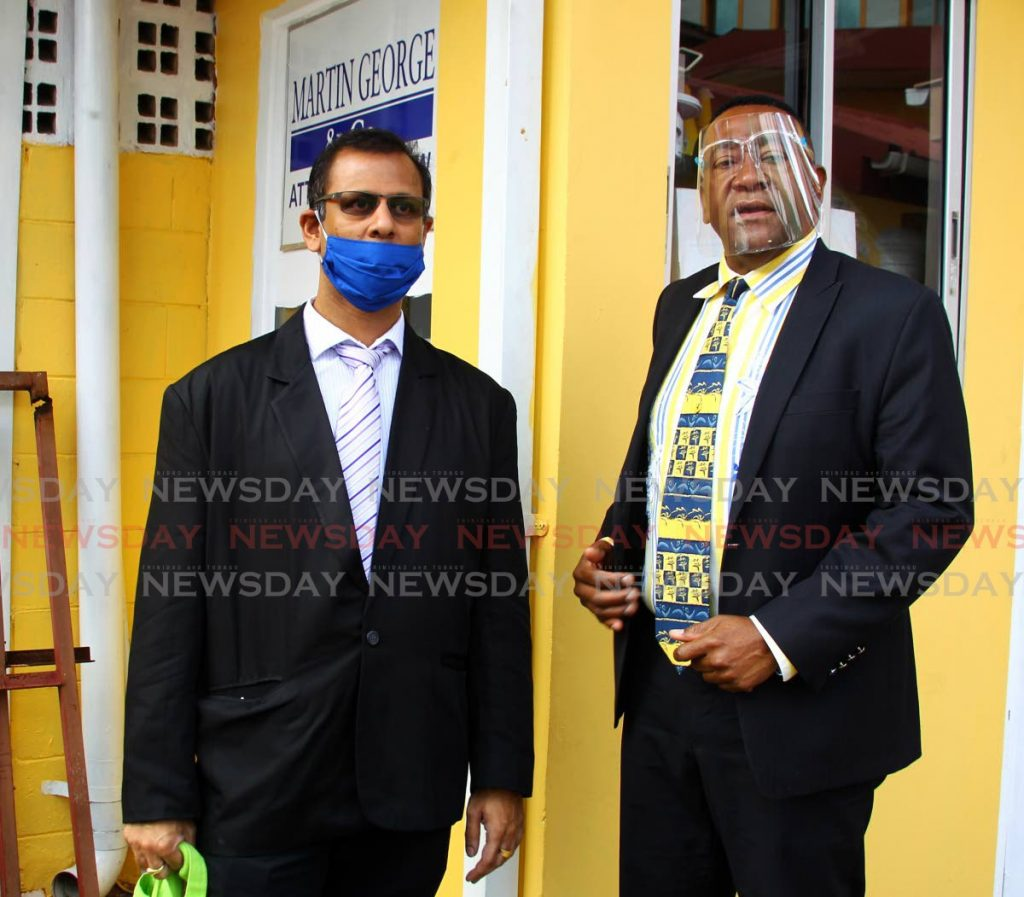 Attorney Martin George with his client Dr Avinash Sawh, who has apologised for a recent voice note that was posted to social media, Dundonald Street, Port of Spain. - ROGER JACOB