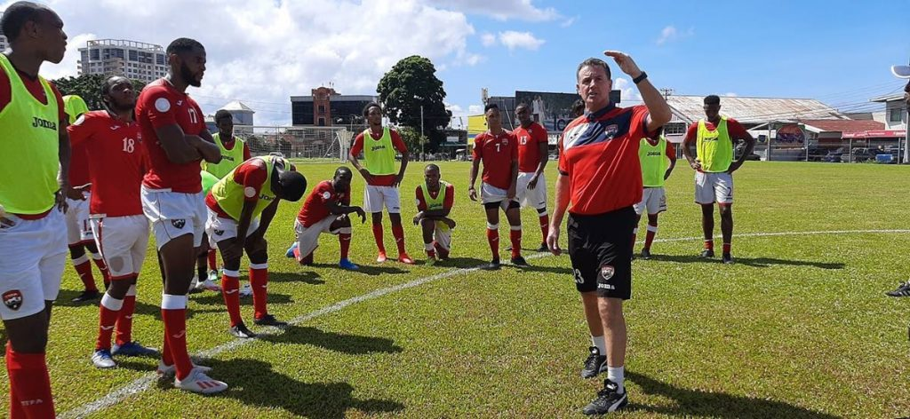 LISTEN UP: National football coach Terry Fenwick talks to his players during a training session at Police Barracks, St James,on November 11.  - TTFA Media