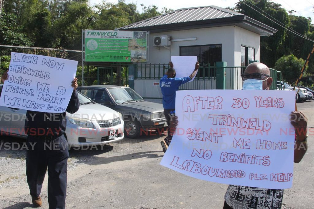 Former Trinweld Contracting Services Ltd workers protested at the company's gate in Marabella on Thursday, calling for their outstanding fringe benefits. Photos by Lincoln Holder