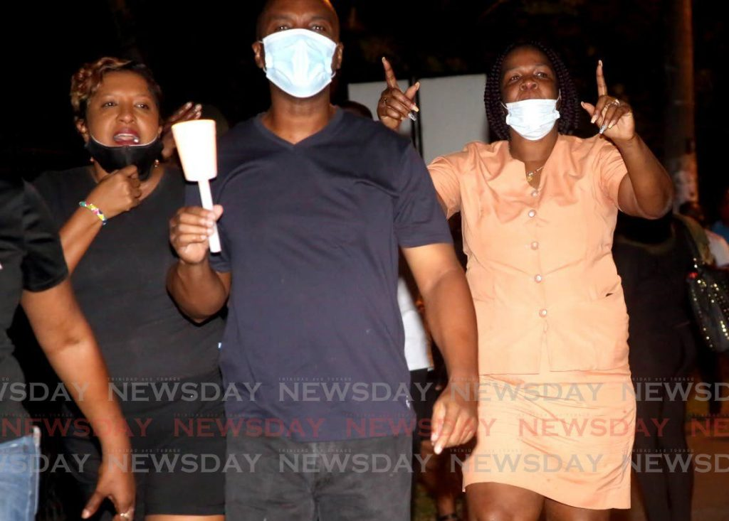 Members of the Drugs Sou Sou (DSS) took their protest outside the  Diplomatic Centre and home of the Prime Minister residence on St Ann's Road in Port of Spain on Wednesday evening. PHOTOS BY SUREASH CHOLAI