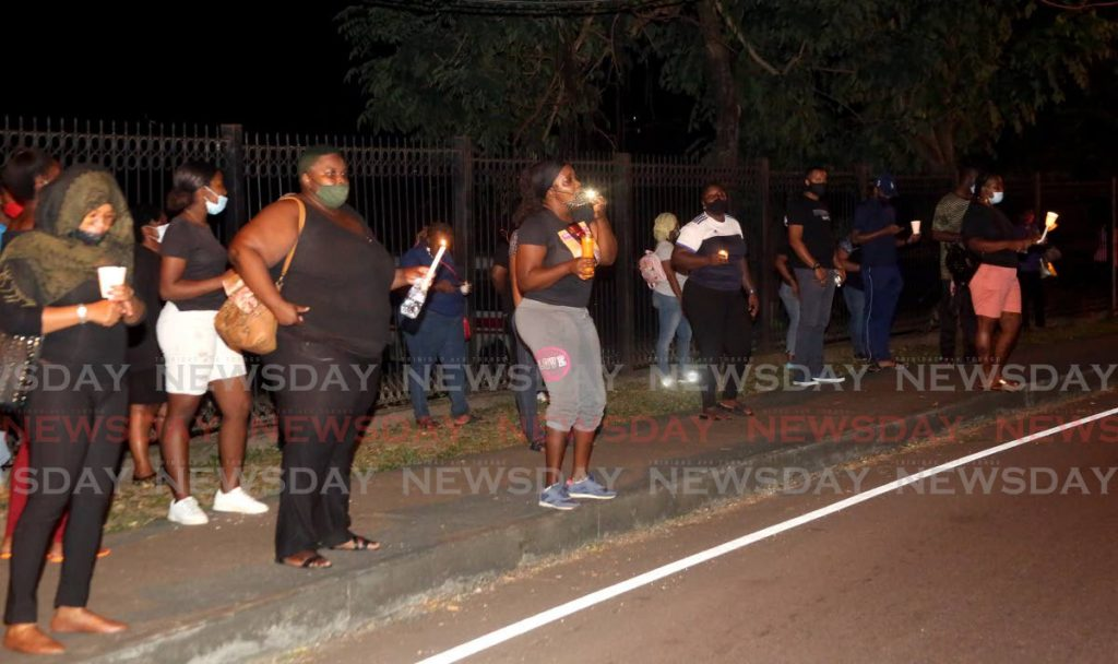 In this November 11  file photo, members of the Drugs Sou Sou (DSS) protest outside the  Diplomatic Centre and home of the Prime Minister residence on St Ann's Road in Port of Spain - SUREASH CHOLAI