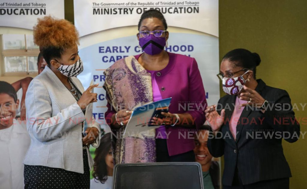 Education Minister Dr Nyan Gadsby-Dolly, from left, permanent secretary Lenor Baptiste-Simmons and acting Chief Education Officer Lisa Henry-David in talks after a press conference announcing changes to the GATE and scholarship programmes at the Education Towers, Port of Spain on November 13. PHOTO BY JEFF MAYERS -