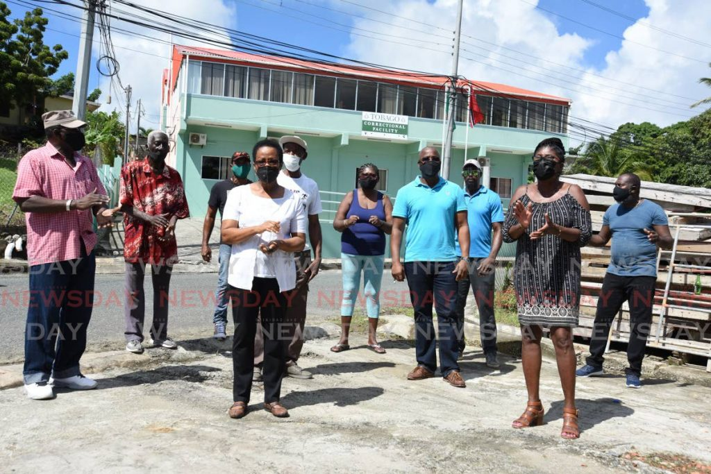 Glen Road residents protest the opening of the Tobago Correctional Facility, background, at Montessori Drive, Glen Road, Scarborough, last week. PHOTO BY AYANNA KINSALE