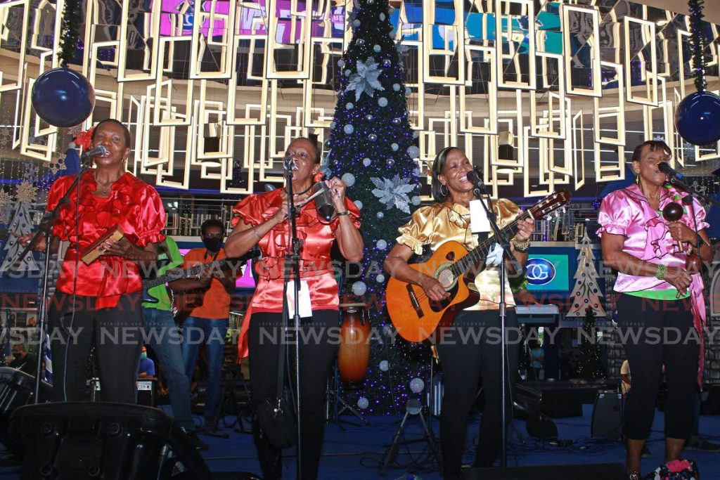 Parang band Los Dinamicos performs at Gulf City Mall's Christmas launch in La Romaine on Ocotber 15. Health Minister Terrence Deyalsingh on Saturday appealed to businesses to not host an office parties and for people to not have family gatherings for the season. PHOTO BY CHEQUANA WHEELER -