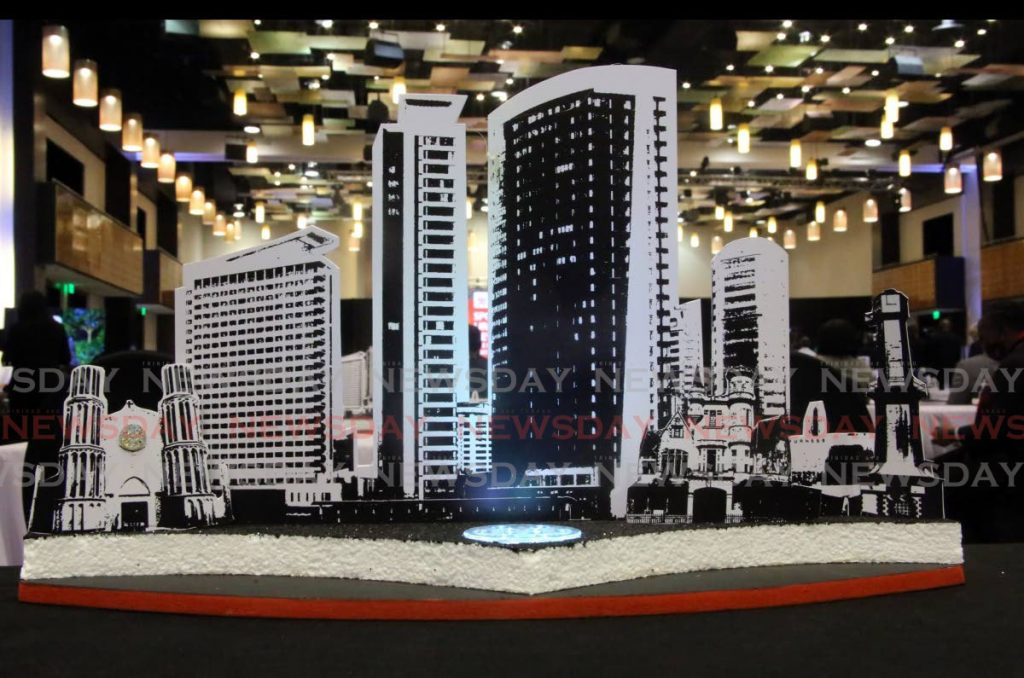 A display highlighting recognisable buildings in Port of Spain was used on each table at the Ministry of Planning and Development's Spotlight on Urban Development at the Hyatt Regency in Port of Spain on Monday. - SUREASH CHOLAI