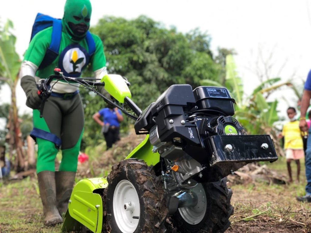Food security and nutrition superhero AGRIman displays the tiller at the handover in Sangre Grande on October 16 - Photo courtesy IICA-TT