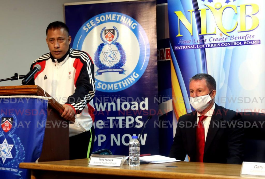 Commissioner of Police Gary Griffith (L) speaks, on Thursday, during the launch of the 2021 Commissioner's Cup, at Police Administration Building, Port of Spain. At right, TT senior men's football coach Terry Fenwick looks on. - SUREASH CHOLAI