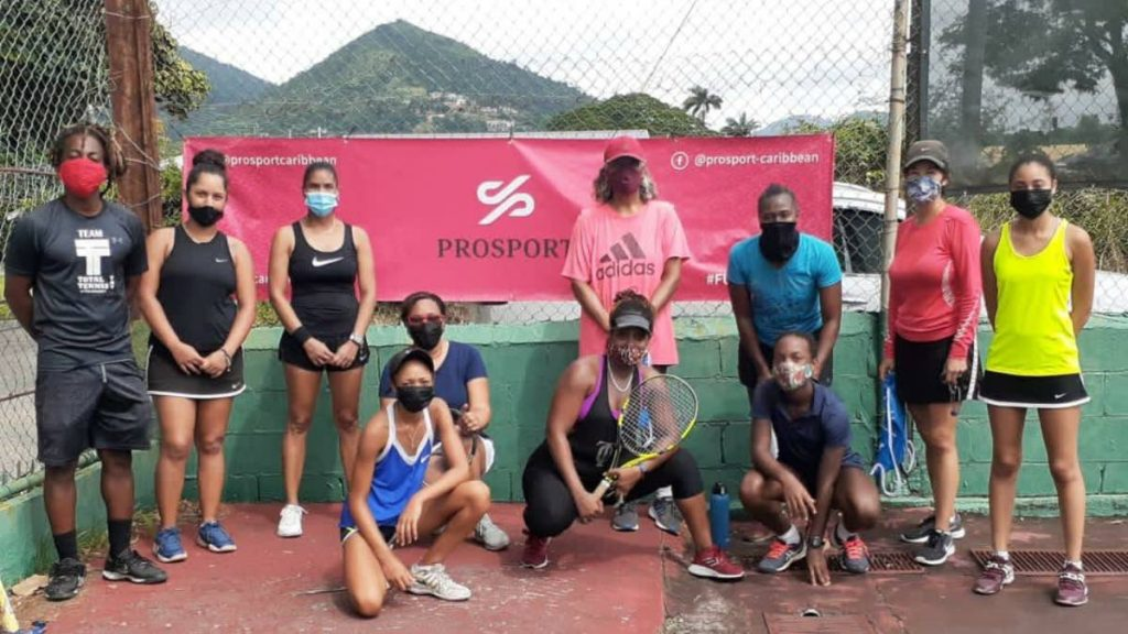 Some of the women's doubles players who took part in Total Tennis' Tiebreak Tens tournament at St. Mary's College courts over the weekend. At left is Total Tennis director Jerome Ward.  - TOTAL TENNIS