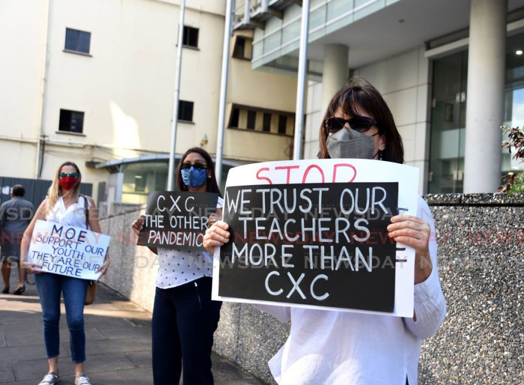 PROTEST: Parents of students who sat the CSEC and CAPE exams earlier this year, staged a protest on Thursday outside the Ministry of Education in Port of Spain.  - AYANNA KINSALE