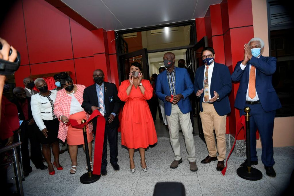 Prime Minister and Diego Martin West MP Dr Keith Rowley celebrates the opening of the Diego Martin South Community Centre with, from left, Diego Martin Regional Corporation counsellor Amber Cain, community centre VP Susan Hong, corporation chairman Sigler Jack, Tobago West MP Shamfa Cudjoe, Diego Martin Central MP Symon de Nobriga and UDecott chariman Noel Garcia on Thursday. -