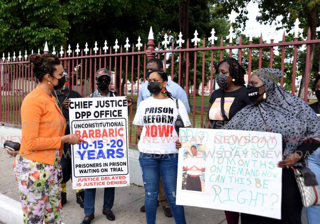 Opposition MP Khadijah Ameen engages protesters advocating for reform of the prison system outside the Red House on Abercromby Street, Port of Spain, Friday. The extension of anti-gang legislation was debated in the House of Representatives that day. - AYANNA KINSALE