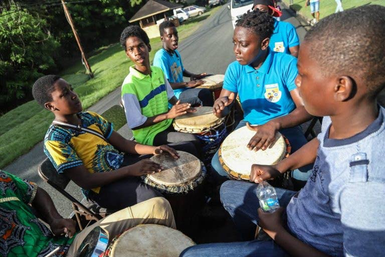 Roxborough Police Youth Club drummers perform at the Wake Up Call procession to launch the Black Rock Sea Festival along Shirvan Road, Tobago. -