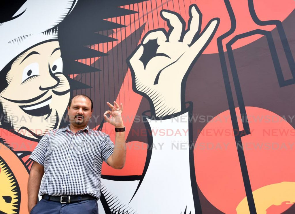 Mario's Pizzeria CEO Roger Harford signals the restaurant chain is here to stay after 48 years as a home-grown enterprise at the newest outlet on Madras Road, St Helena. PHOTO BY AYANNA KINSALE  -