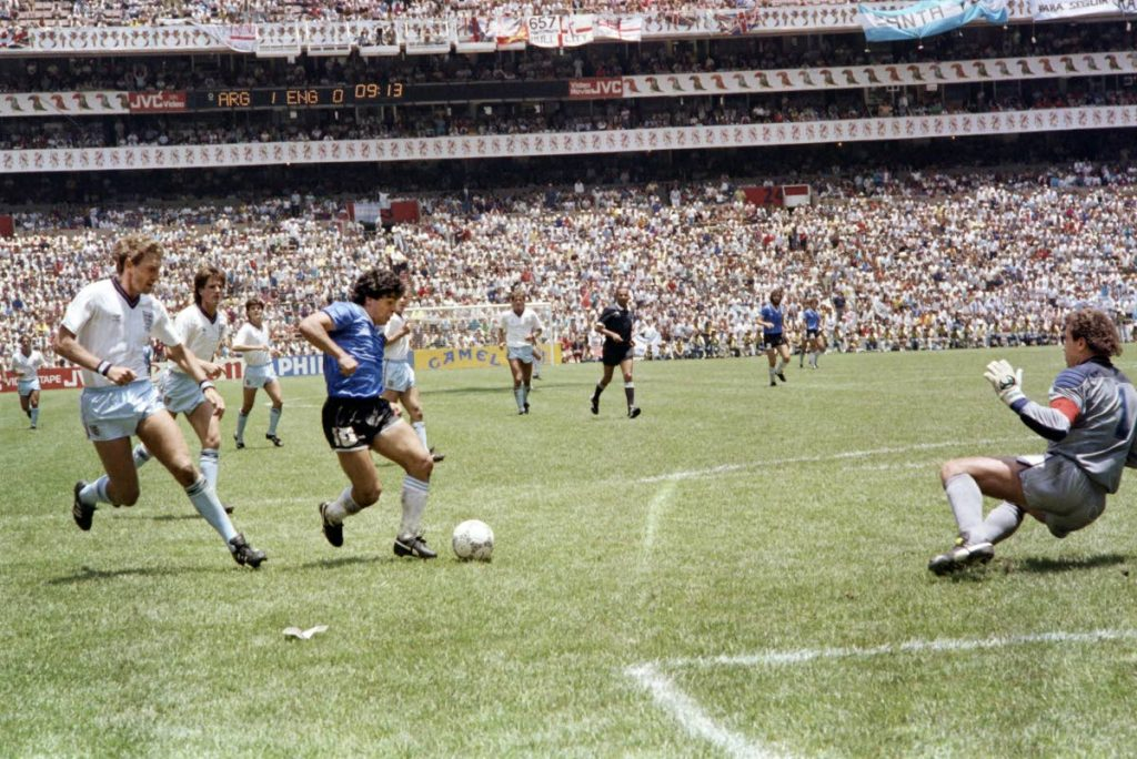 In this file photo taken on June 22, 1986 Argentinian Diego Armando Maradona shoots to score a sensational goal past England goalkeeper Peter Shilton in the World Cup quarterfinal in Mexico City. Argentina won 2-1. (AFP) -