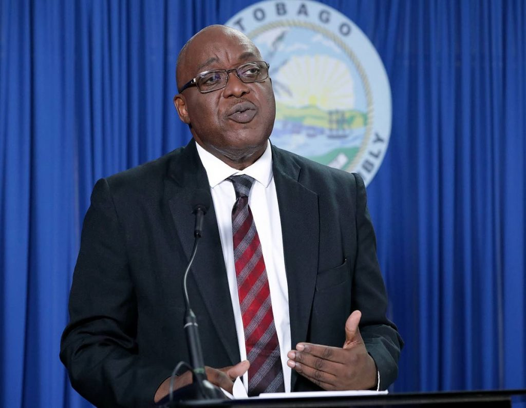 Secretary of Education Kelvin Charles speaks to the media about digital devices procured for students on Wednesday. PHOTO COURTESY THA INFO DEPARTMENT   -