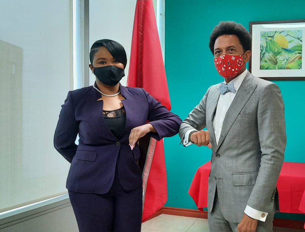 Minister of Sport and Community Development Shamfa Cudjoe, left, with newly appointed SIGA Council Standing Committee chairman Brian Lewis.  - Ministry of Sport