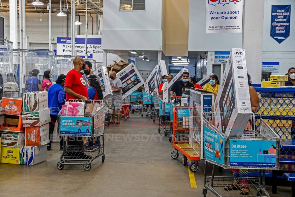 Customers at PriceSmart, capitalised on the Black Friday sale. Most were seen leaving with TV's at the Chagaunas branch on Friday morning. - MARVIN HAMILTON