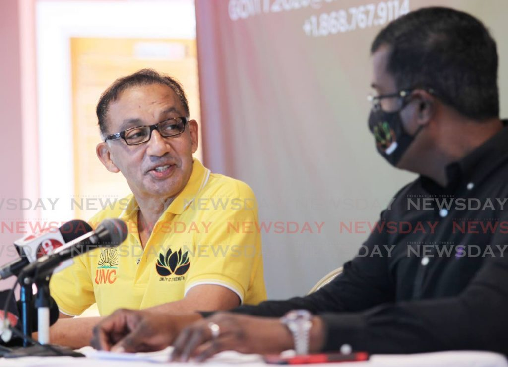 UNC political leader candidate Vasant Bharath and chairman candidate Larry Lalla, on the Team Lotus slate, discuss concerns about the party's election during a media conference at Gaston Court, Chaguanas on Saturday. PHOTO BY LINCOLN HOLDER -