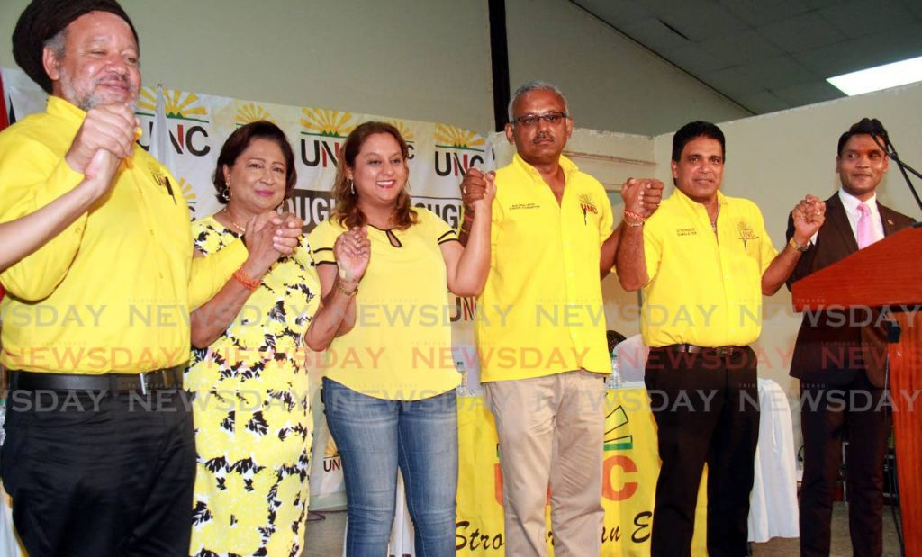 FILE PHOTO: Then Couva North MP Ramona Ramdial, centre seems secure next to UNC Political Leader Kamla Persad-Bissessar during a Monday Night Forum meeting at the party's Couva South Office back in October 2018. Ramdial has since been replaced by Ravi Ratiram in Parliament after she was not selected by her party to run for the seat in the August 10, 2020 general election. Others in the photo are, from left, Henry Awong, Rudranath Indarsingh, Roodal Moonilal and Barry Padarath. -
