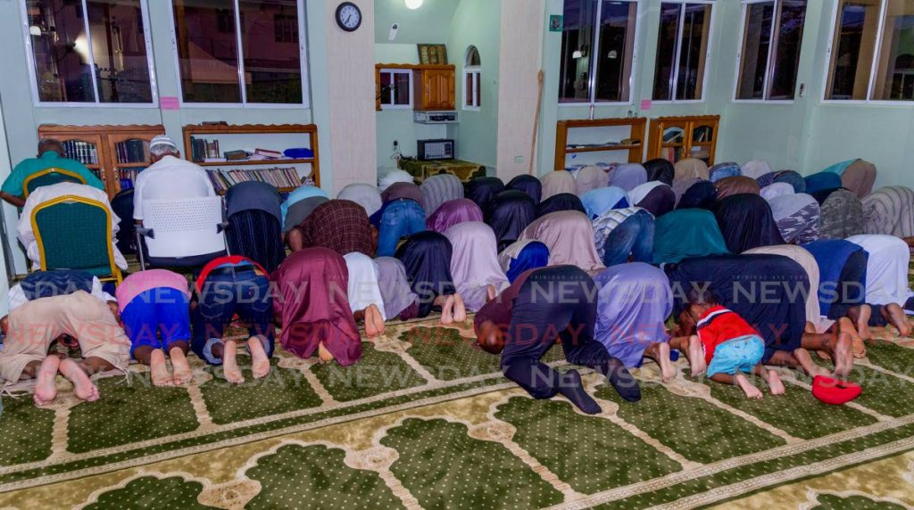 In this May 20, 2019 file photo, Muslims prayer at the Masjid Al Tawbah in Lowlands, Tobago. Sometimes a Muslim worker may want time off to attend Friday prayers which may conflict with the job.   PHOTO BY DAVID REID - DAVID REID
