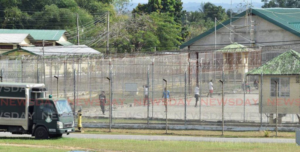 File photo: Prisoners exercise in the general area of the remand section of the maximum security prison in Arouca.