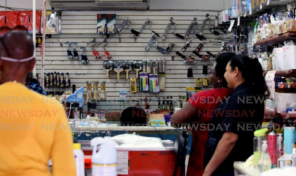 Customers waiting in line at a hardware store in Port of Spain. Photo by Sureash Cholai-