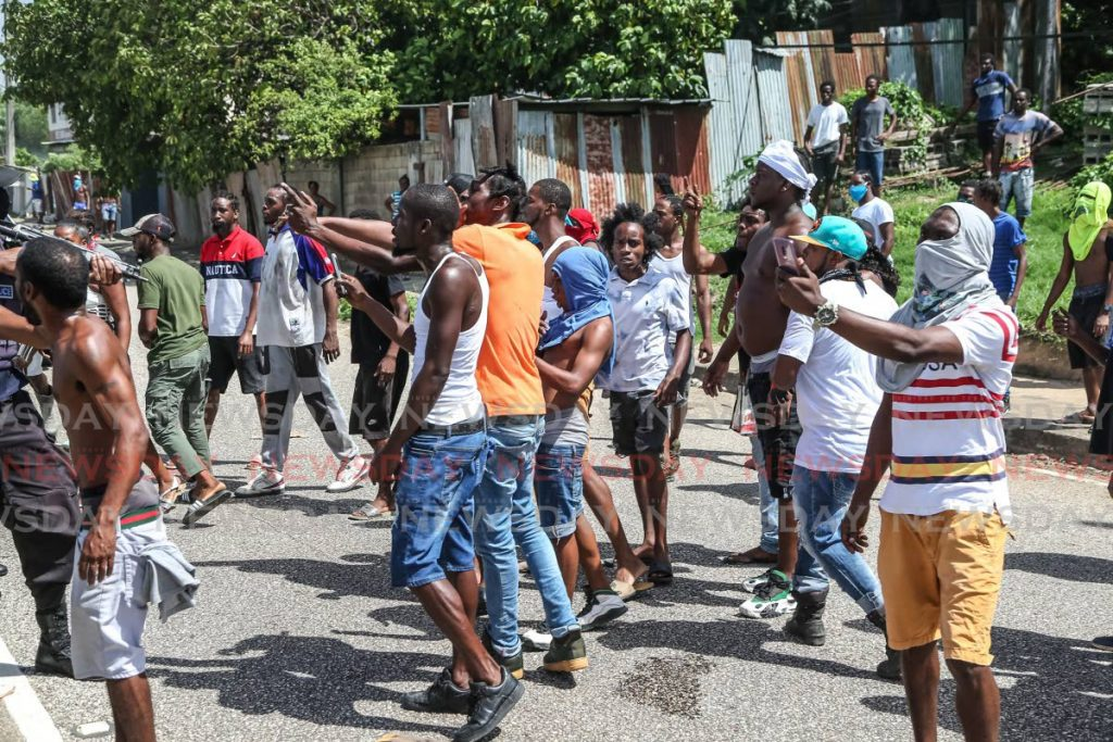 In this June 30, 2020 file photo, residents protest in east Port of Spain days after the police killings of three men in Morvant. PHOTO BY JEFF MAYERS -