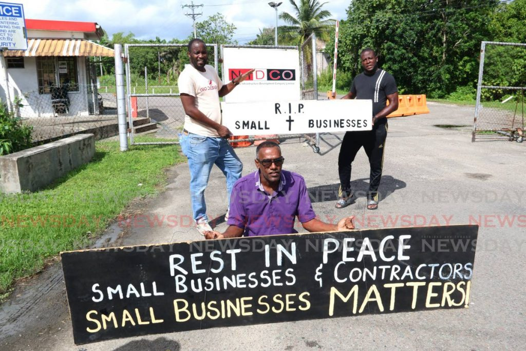 In this July 20 photo, small contractor Alastai Ramharack and others protest at near the OAS compound in Golaconda, San Fernando. The effects of the pandemic lockdowns and restrictive practices, and companies' desperate scramble for survival over the last year have increased the stress levels and mental stamina of many people. - Marvin Hamilton