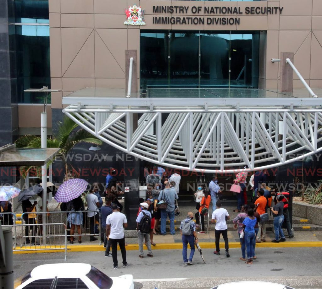 In this file photo, people wait outside the Immigration Division at the Ministry of National Security on Richmond St, Port of Spain. The Government has signaled its intention to improve the digital delivery of public services. - SUREASH CHOLAI