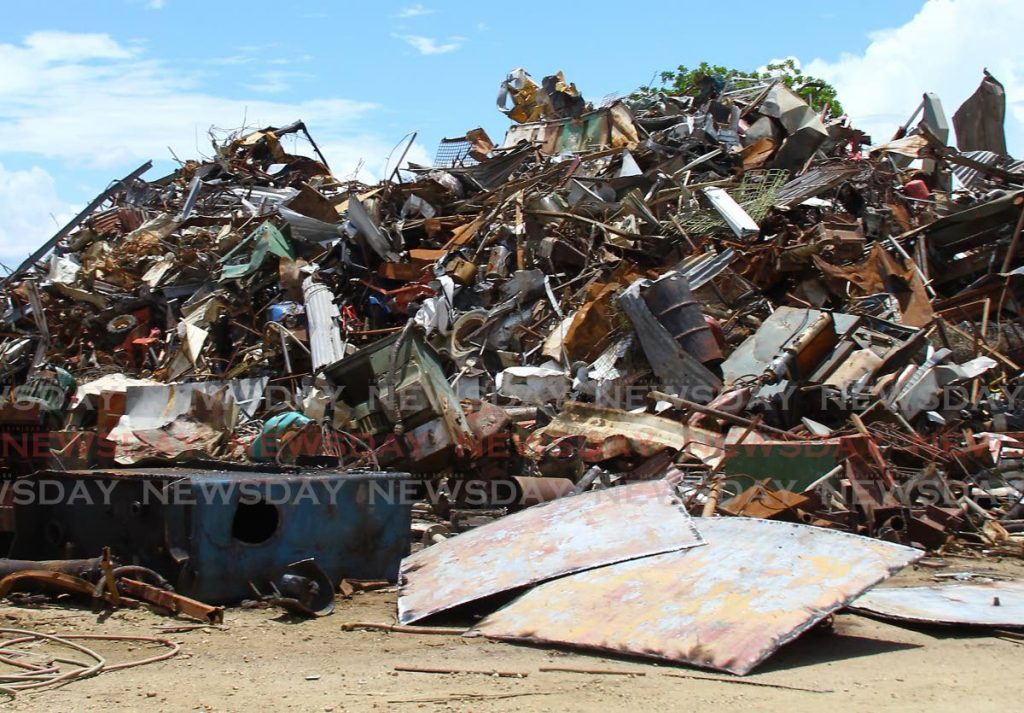 A mound of scrap iron in a yard in Piarco for sorting and packing in containers to be shipped for export. PHOTO BY ROGER JACOB -
