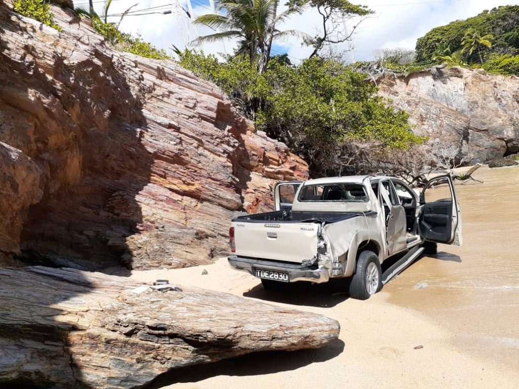 A Toyota Hilux found abandoned on a beach in Penzance, Balandra, on Thursday morning.  PHOTO COURTESY TTPS - TTPS
