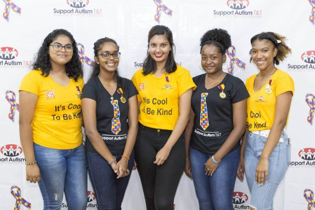 Vaani, centre, and Chelsi, far right, along with other autism Youth Ambassadors of Support Autism T&T. - Sataish Rampersad