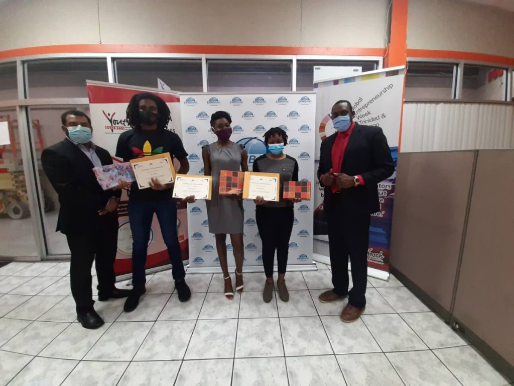 Sheldon Thomas, marketing manager, Eximbank, left;  Ireal Daly, Naparima College, third place;  Akiela Browne, ASJA Girls' College, Barrackpore, second place; and winner of the School Export Pitch Competition, Desaiae Defour of Bishop Anstey High School with  Shedron Collins, general manager, YBTT.    -
