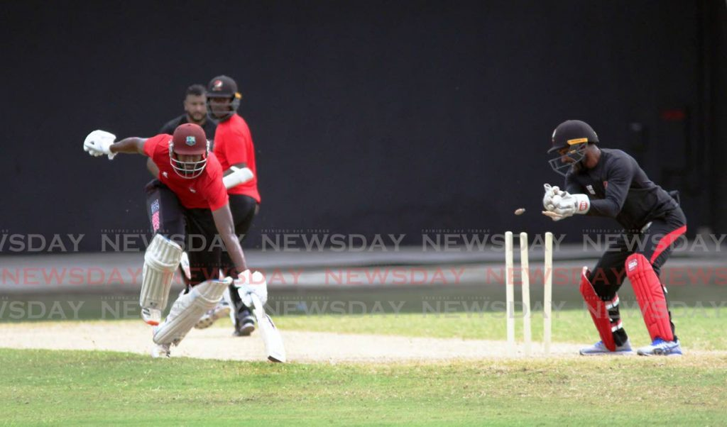 Jyd Goolie (left) of the Imran Khan XI survives an attempted run-out during Friday's TT Red Force practice match against the Denesh Ramdin XI at the Brian Lara Cricket Academy, Tarouba. PHOTO BY LINCOLN HOLDER. - Lincoln Holder