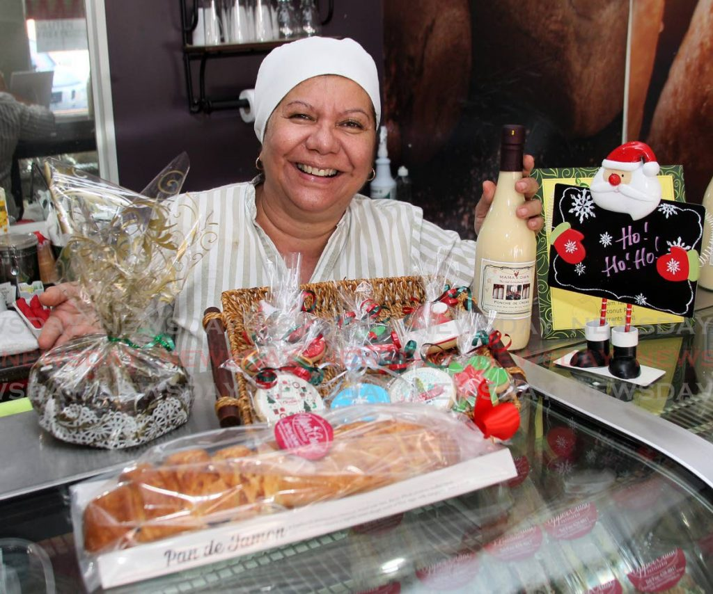 Katrina Phillips, 60, owns Upper Crust Patisserie in St James. Her restaurant is classified as a bakery and was able to stay open during lockdown. Christmas this year, she said, will be a return to traditional values of sharing a meal and spending time with family.   - ROGER JACOB