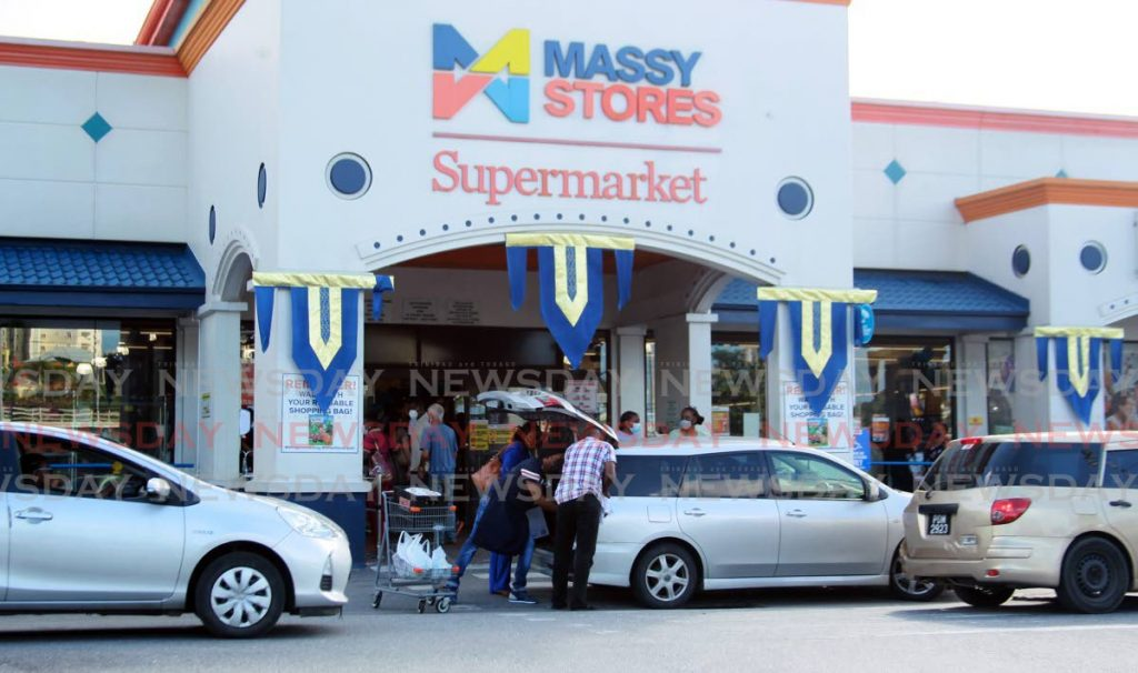 File photo: Customers after shopping at Massy Stores Supermarket, Westmoorings.   Photo by Roger Jacob