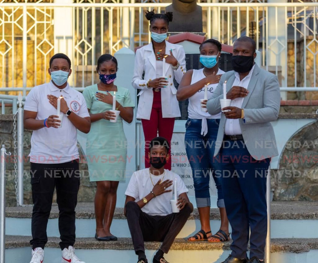 Members of the Youths Elevatng Youths, Resin Art TT and Caricon Youth Ambassadors for TT raise awareness for victims of domestic violence at James Park, Scarborough, Wednesday. PHOTO BY DAVID REID -