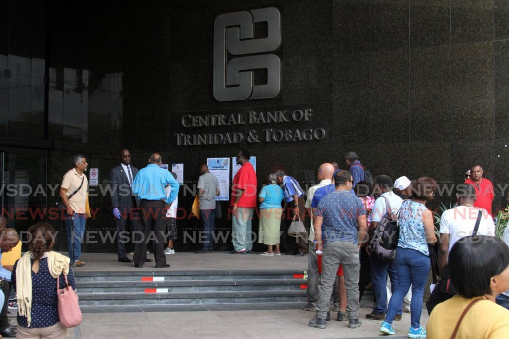 In this March 17, 2020 file photo members of the public wait to enter the Central Bank in Port of Spain. This photo was taken before physical distancing and mask-wearing were mandatory under covid19 public health measures. FILE PHOTO/ANGELO MARCELLE -