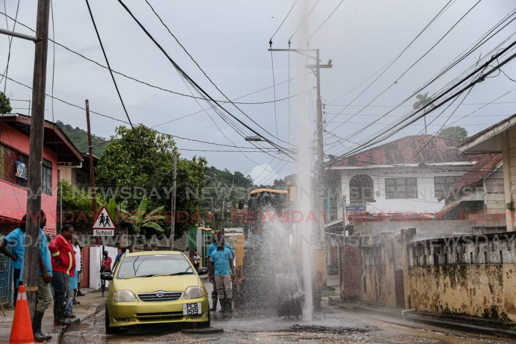 In this July 28, 2020 file photo WASA workers on location to repair a burst main on St Francois Valley Road, Belmont. FILE PHOTO/JEFF MAYERS. -