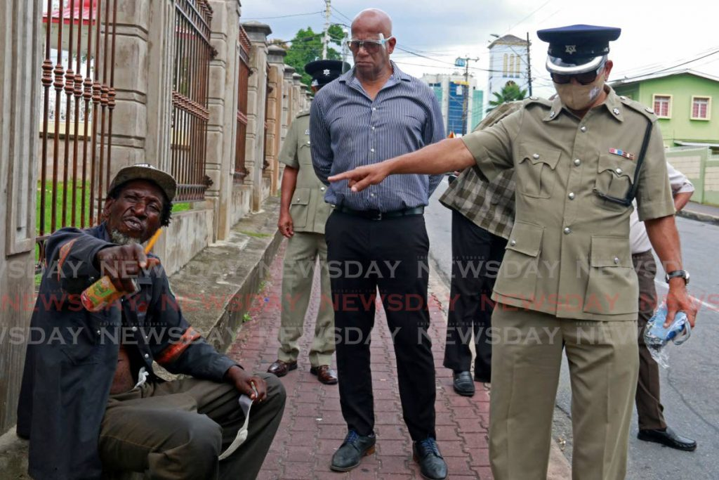 FLASHBACK: Senior Supt Yusuf Gaffor instructs a homeless man to put on a mask during a walkabout with San Fernando Mayor Junia Regrello in September last year. - Marvin Hamilton