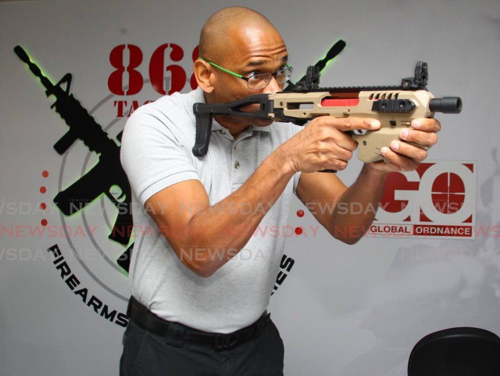 Dirk Barnes, owner of 868 Tactical Firearms and Accessories demonstrates some of the equipment on sale. PHOTO: ROGER JACOB - ROGER JACOB