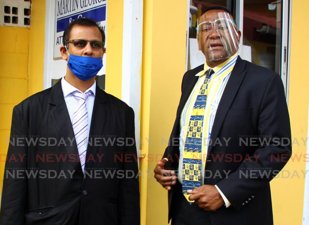 File photo: Dr Avinash Sawh, left, and his attorney Martin George at a news conference at George's Port of Spain office in November last year.