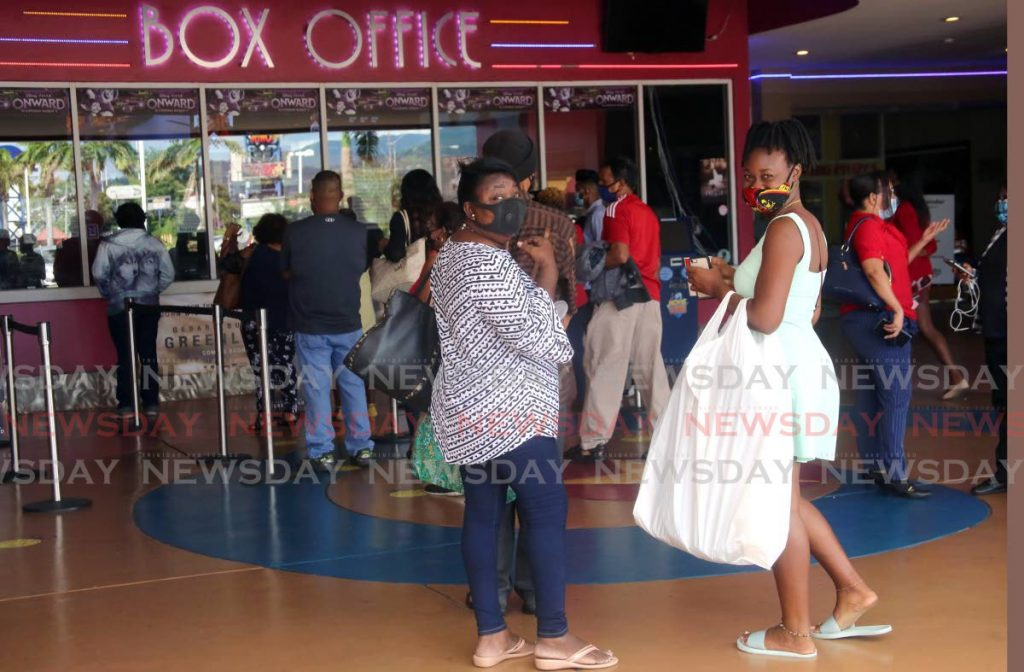 In this November 2020 photo, moviegoers wait to buy tickets at  the MovieTowne, Port of Spain box office when the cineplex reopened after months of covid19 restrictions. FIle photo by Sureash Cholai