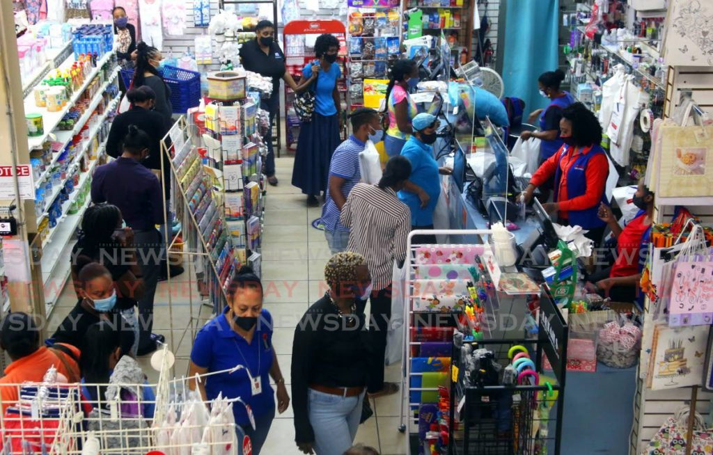 In this November 27, 2020 file photo, shoppers cash in on the closing down sale at Excellent Stores, Frederick Street, Port of Spain.  - PHOTO BY SUREASH CHOLAI