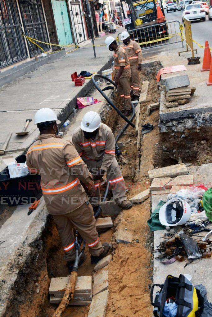 File photo: T&TEC workmen repairing underground cables. - Vidya Thurab