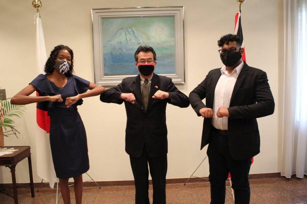 Ambassador Tatsuo Hirayama (centre) pose with MEXT Scholarship students Afia Boney (left) and Jonathan Ramtahal (right) at the Embassy of Japan TT, St Clair - Embassy of Japan