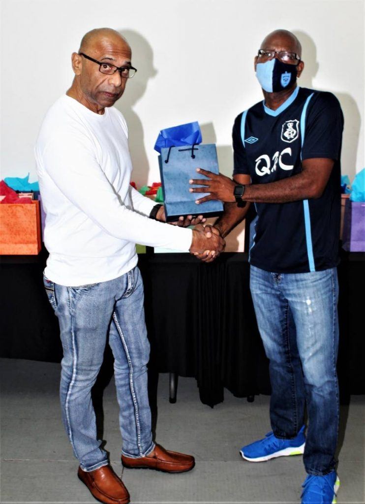QRC principal David Simon, right, receives one of the tablets. -